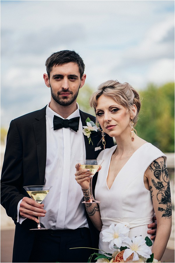 Tattooed Bride in chic wedding suit