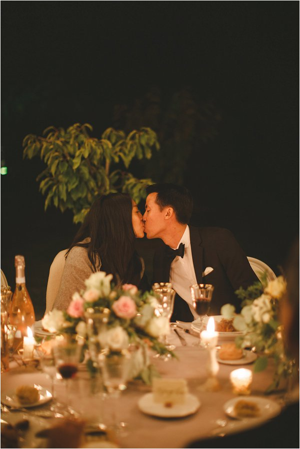 The bride and groom exchange a kiss under the moonlight