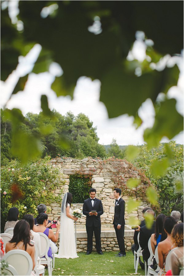 The bride and groom exchanging vows in outdoor Provence ceremony