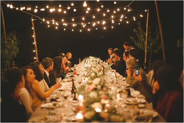 Wedding guests enjoying hospitality into the night