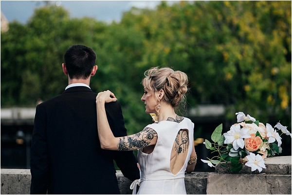 open back bridal outfit showing tattooed bride
