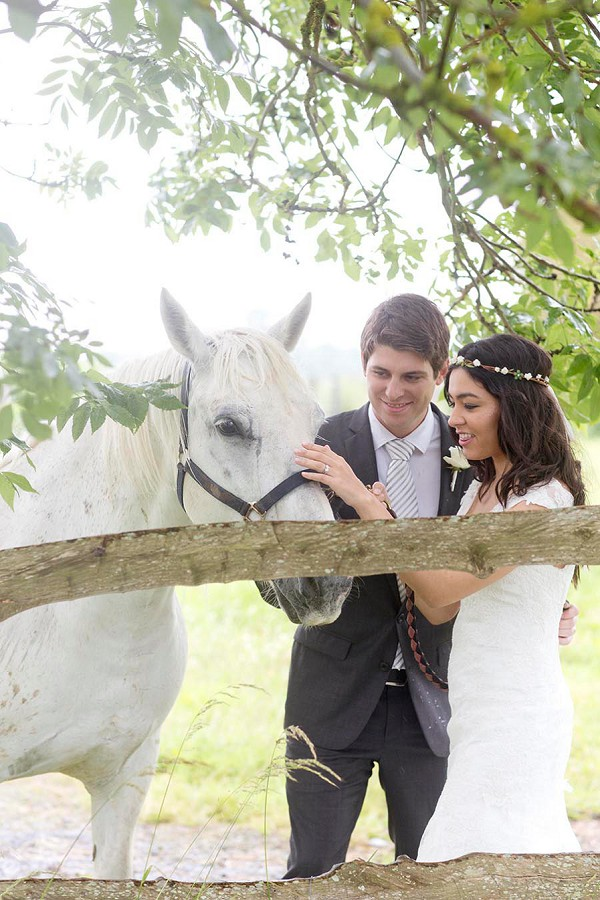 Bride, Groom and white horse shot