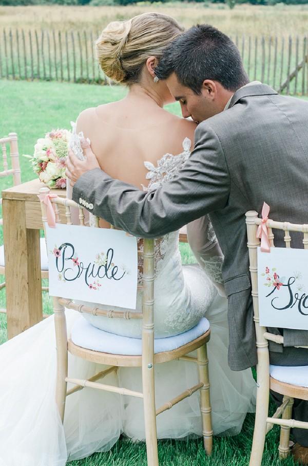 Bride and groom seat signs