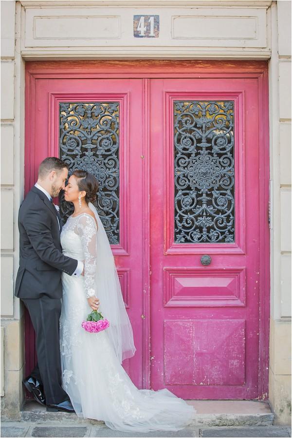 Wedding portraits against beautiful door in Paris