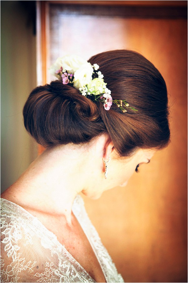 chic bridal up do with real flowers