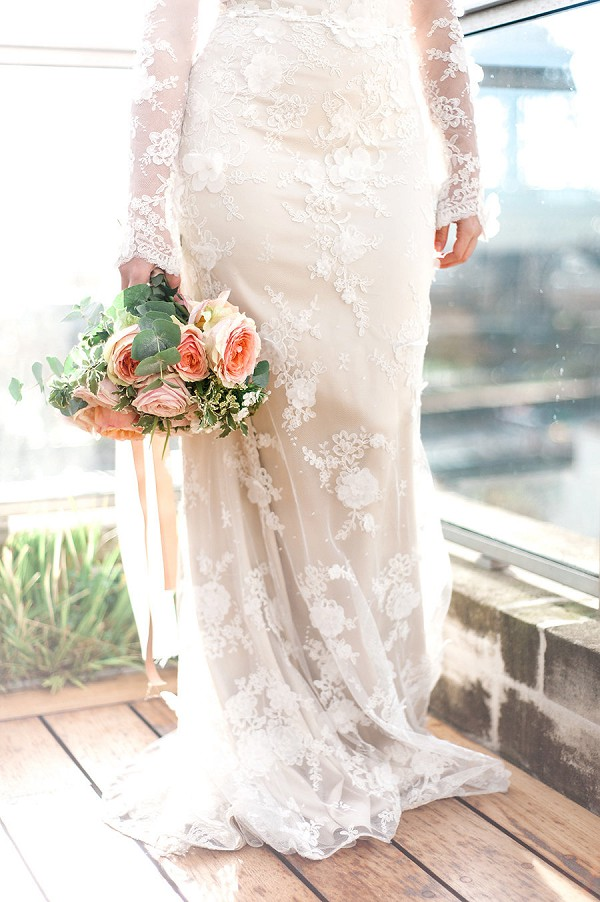 Sheer lace wedding gown with sleeves