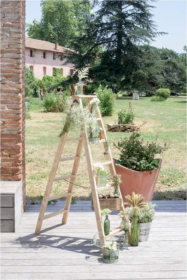 decorative wedding ladder and plants
