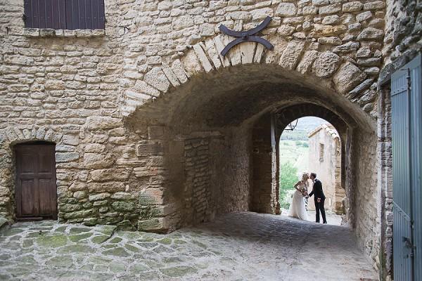 Archway wedding day kiss
