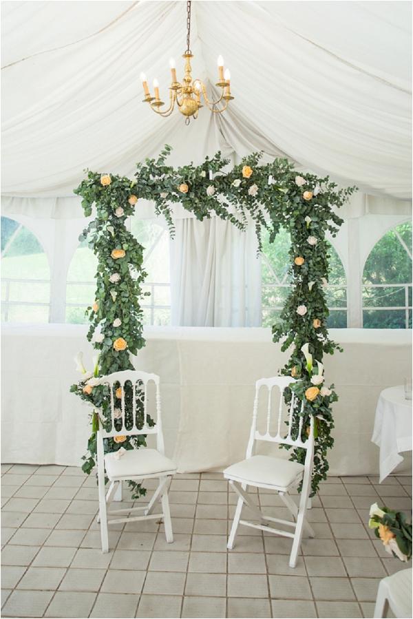 floral wedding arch backdrop | Image by Freddy Fremond