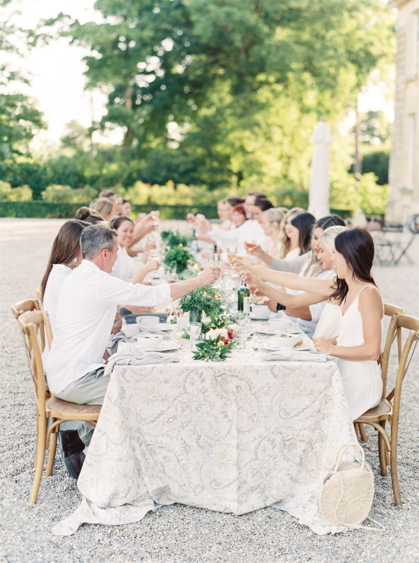 Wedding party dine outside Chateau de Courtomer in Normandy Wedding