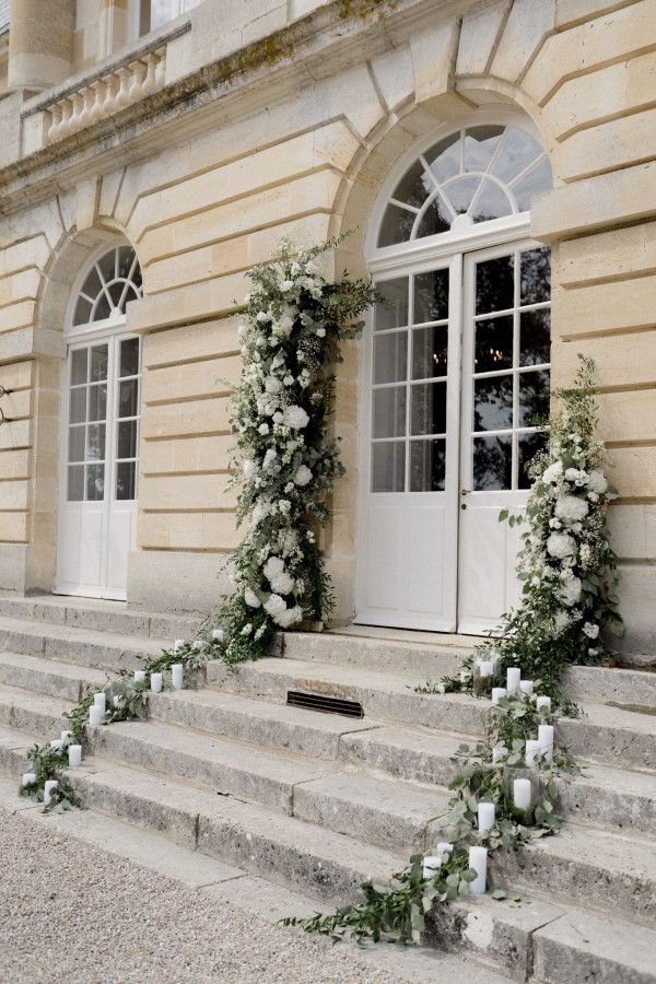 Chateau de Courtomer facade decorated with trailing white flowers
