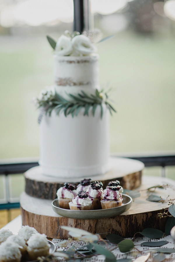 two tier wedding cake and cupcakes