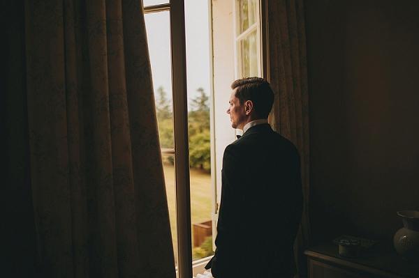Chateau wedding groom portrait
