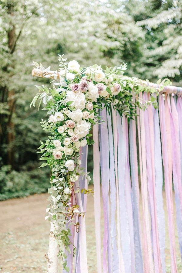 ribbon and roses wedding arch