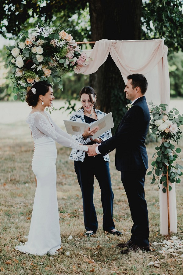 floral and linen arch