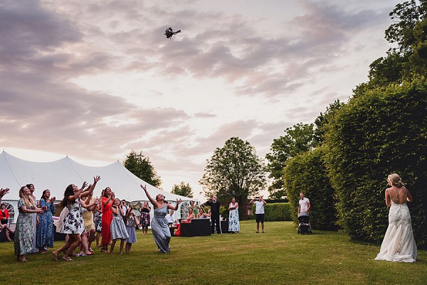 Outdoor wedding bouquet toss