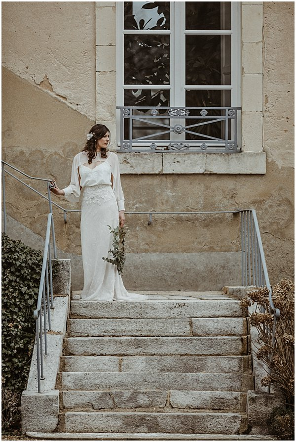 beautiful bride posing in a staircase
