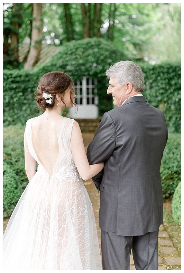 beautiful bride walking with her father