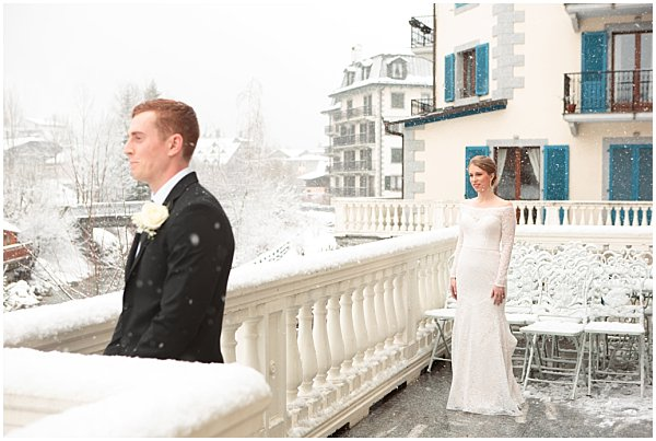 bride and groom looking at the beautiful town at the french alps