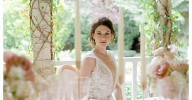 bride in white dress with rose designs