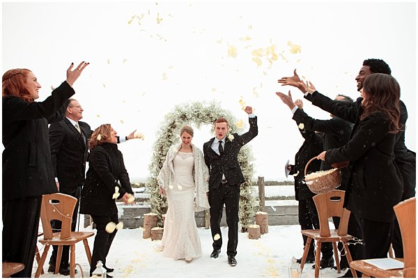 couple and family celbrate after wedding ceremony