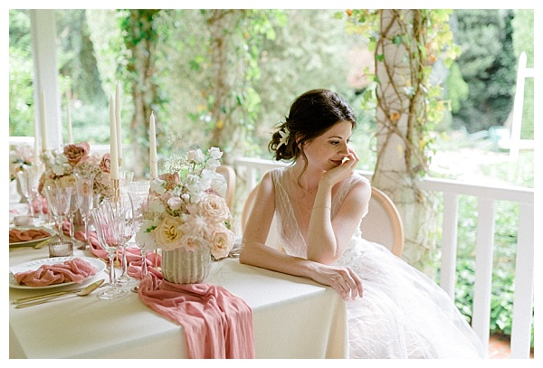 lovely bride at the table with roses