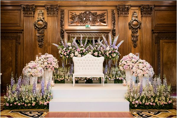 Paula Rooney luxury wedding stage for bride and groom in flowers, on French Wedding Style