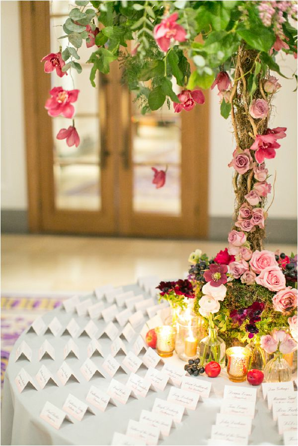 Paula Rooney dramatic rose wedding escort card table centre