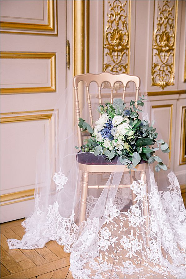 bridal veil and bouquet at Winter Wedding in Paris