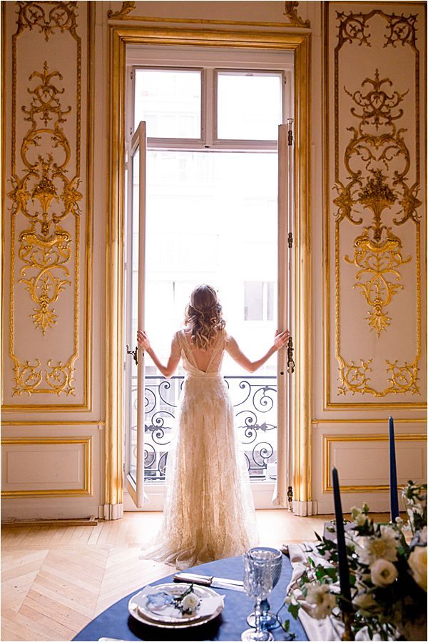 elegant bride at the balcony Winter Wedding in Paris