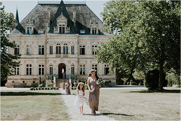walking to the ceremony at Chateau de la Valouze