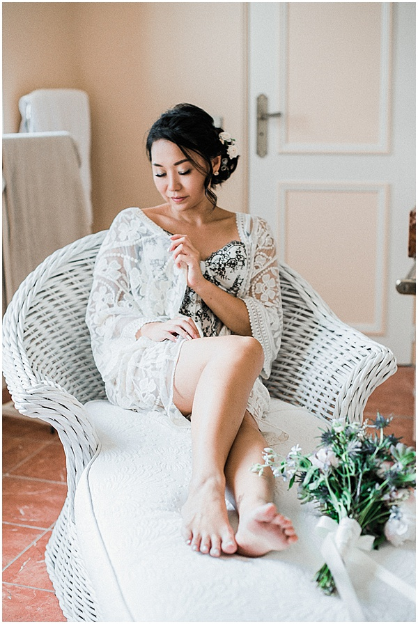 Bride relaxing before her French Destination Wedding