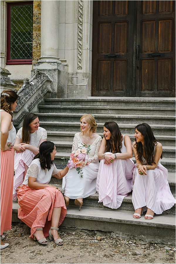 bride catching up with friends in wedding at Château de Méridon
