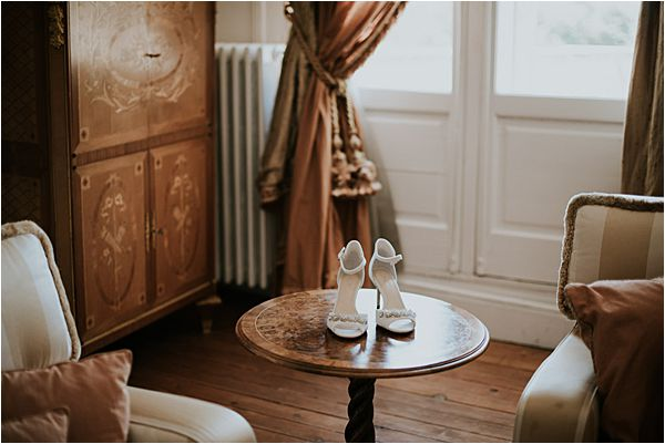 bride's shoes at Chateau de la Valouze