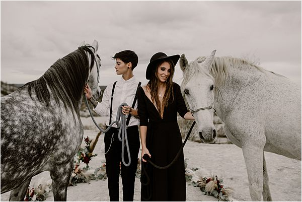 couple in beautiful horses at international wedding photography