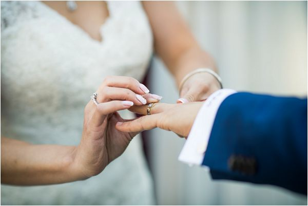 exchanging vows for a destination wedding by Janis Ratnieks Photography