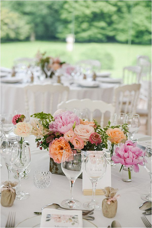 lovely flowers at the table in wedding at Château de Méridon