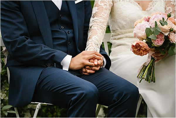sweet locking of hands during the wedding at Château de Méridon