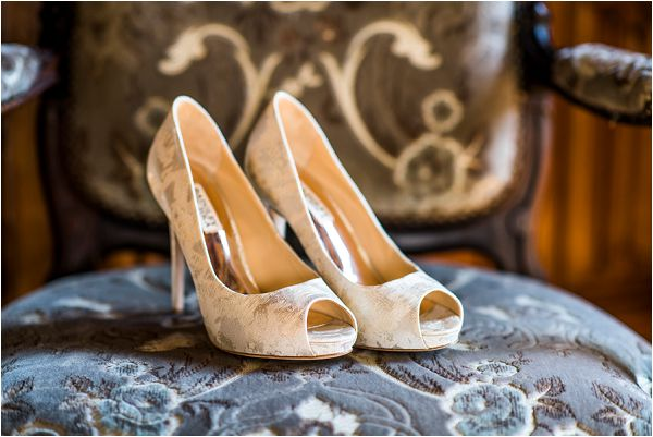 white embroidered bridal shoes at Chateau Challain by Janis Ratnieks Photography