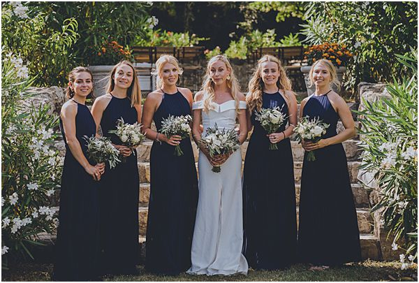 Bride with Navy Bridesmaids Dresses