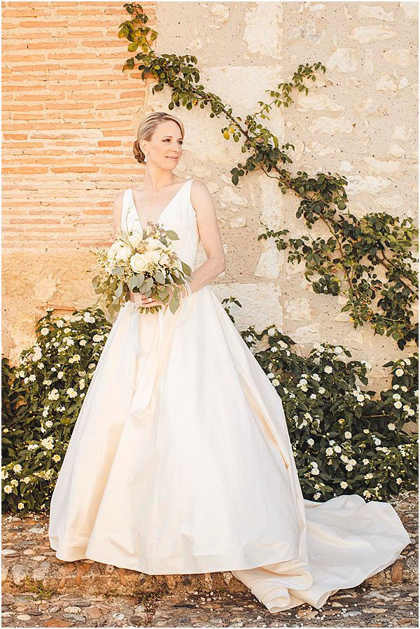 Ivory Gown with Green Foliage Background