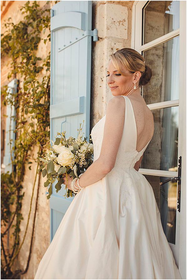 Klienfeld Bridal Gown with Rose Bouquet