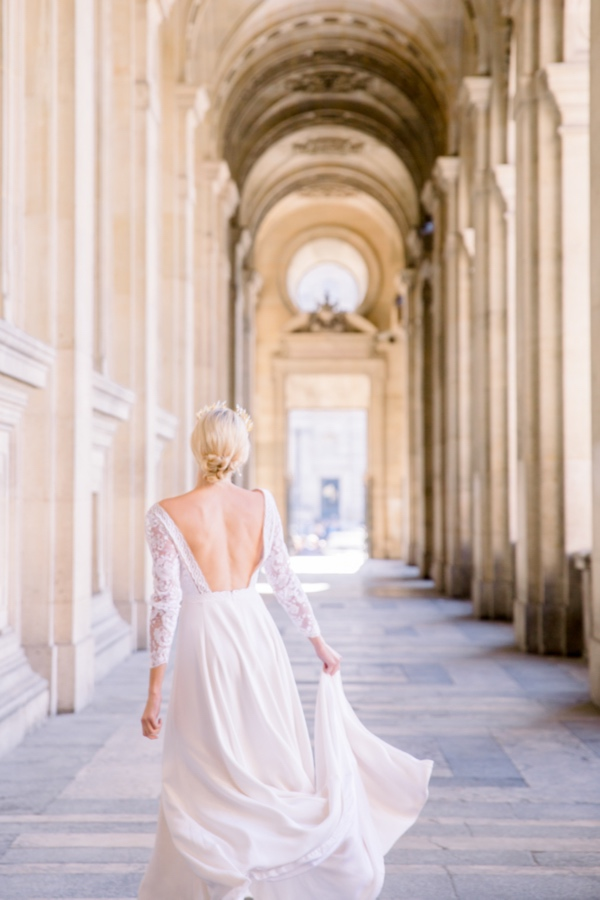 Paris Bride holding dress
