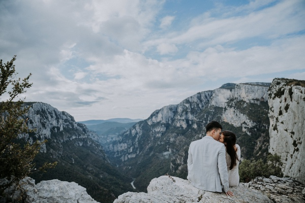 Wedding Couple sitting on Mountain
