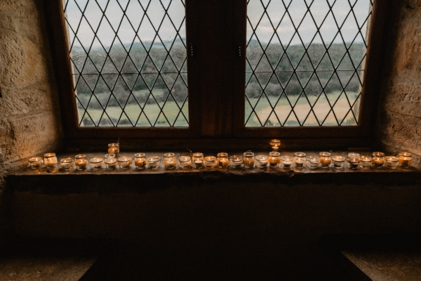 candles against double window chateau