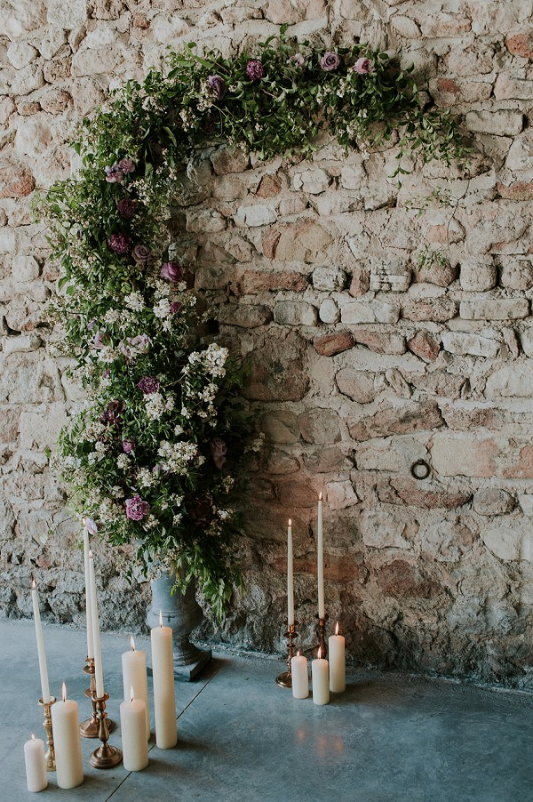 candles and flowers wedding arch