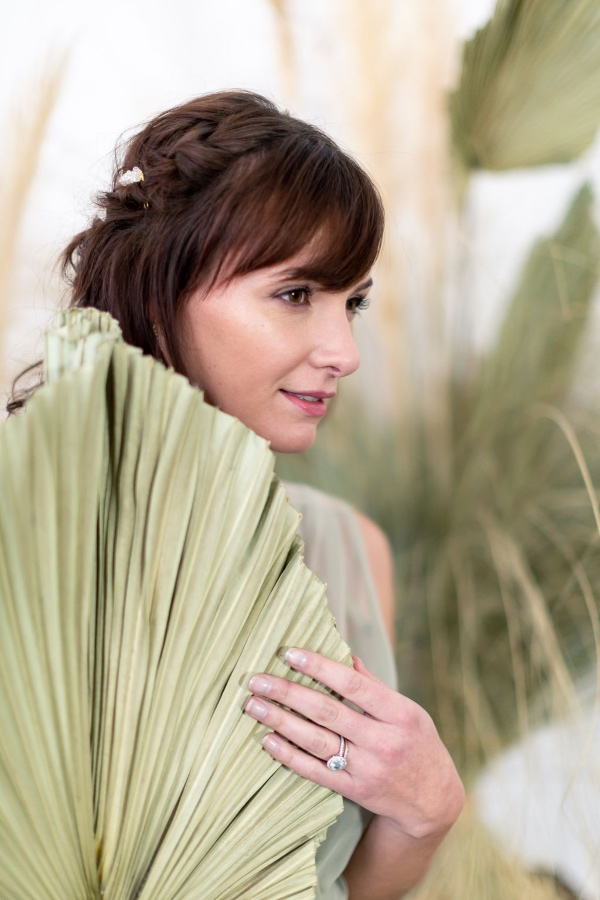 bride hiding behind palm leaf