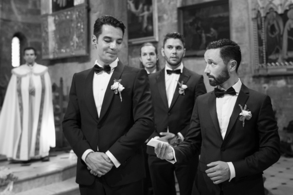 groom and groomsmen with black bow tie