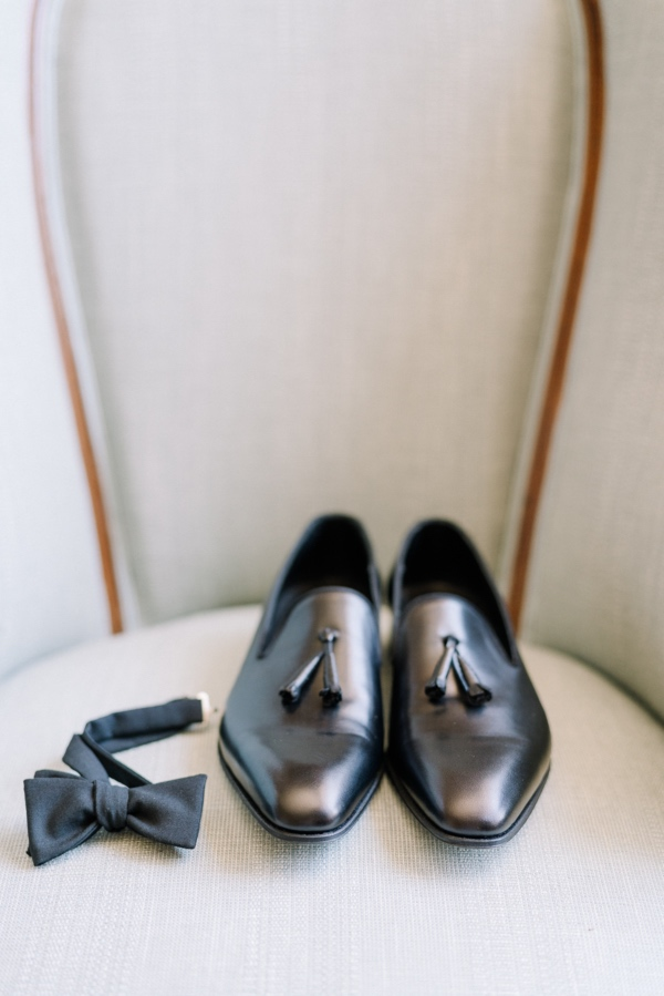 groom black shoes and bow tie