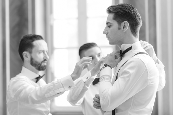 groom fixing bow tie